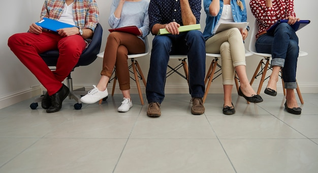 Candidates waiting for a job interview. Free Photo