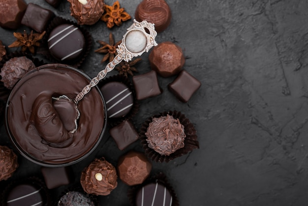 Candies and melted chocolate with copy space Free Photo