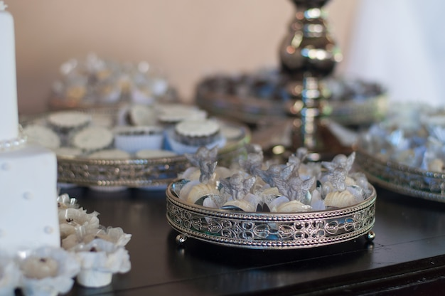 Candies on the table - baptism Premium Photo