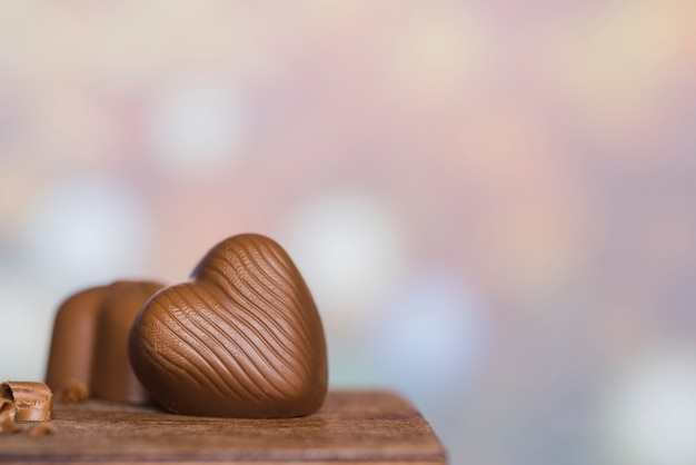 Candies on wooden table Free Photo