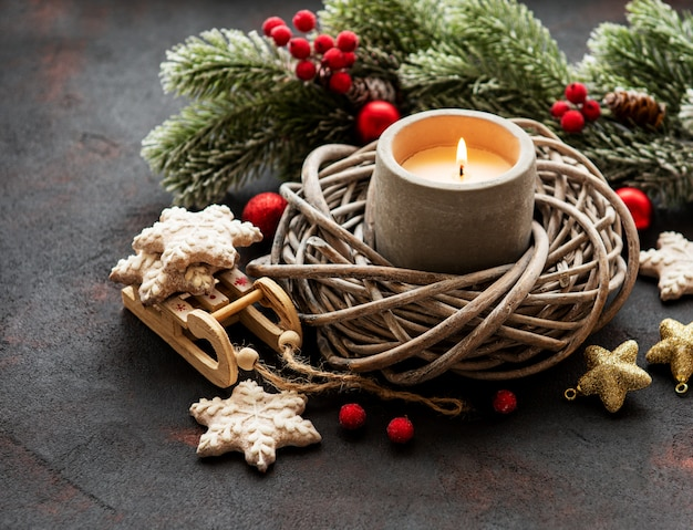 Candle and christmas decorations Premium Photo