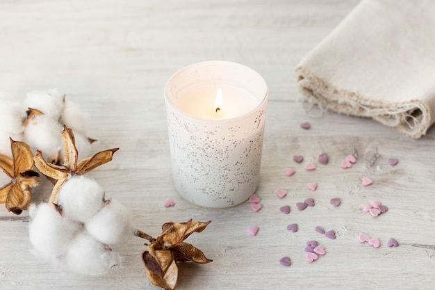 Candle and cotton flowers for valentines day Free Photo