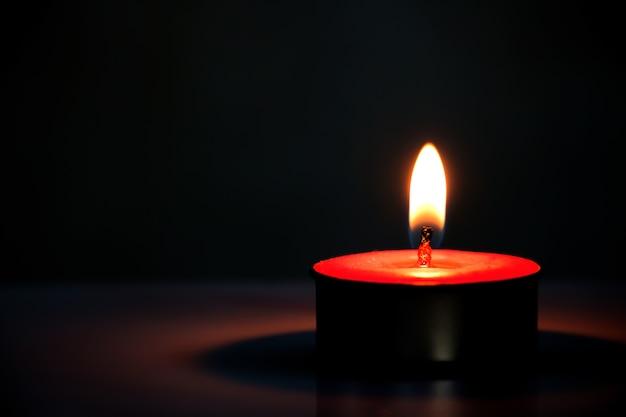 Candle Light On A Dark Background Premium Photo