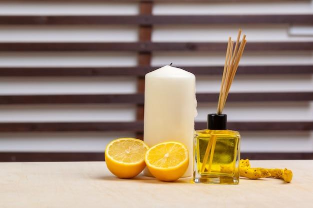 Candle, oranges, home fragrance Premium Photo