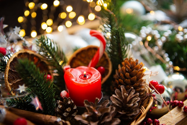 Candle with fir branches Premium Photo