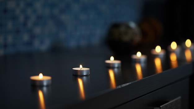 Candles burning in darkness and created peaceful atmosphere Premium Photo