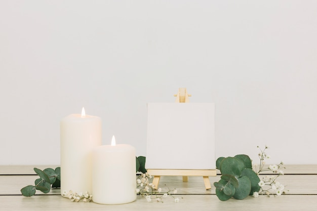 Candles with a blank canvas Free Photo