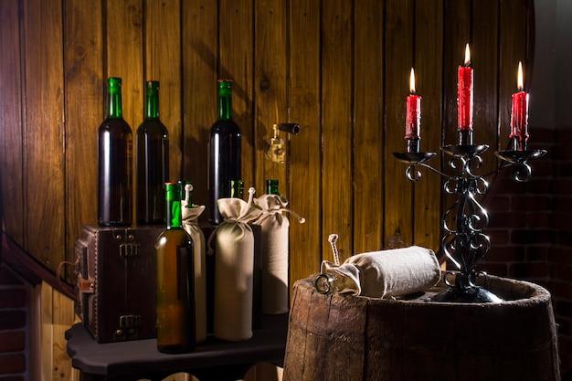 Candlestick in the wine cellar Premium Photo