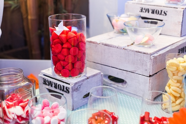 Candy bar. delicious sweet buffet with cupcakes and jelly beans Premium Photo