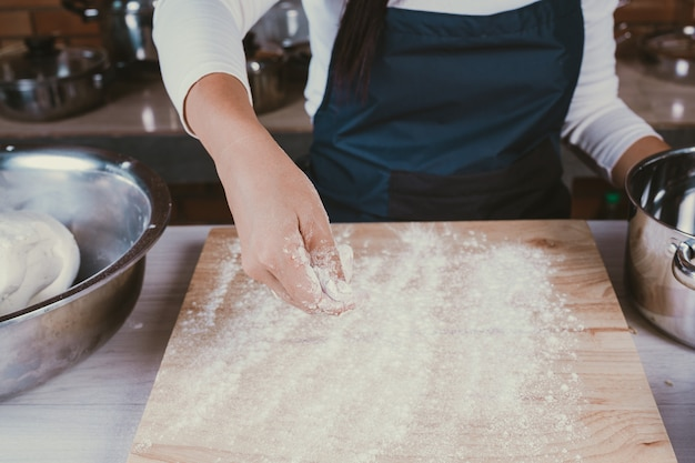 Candy girl in the kitchen. Free Photo