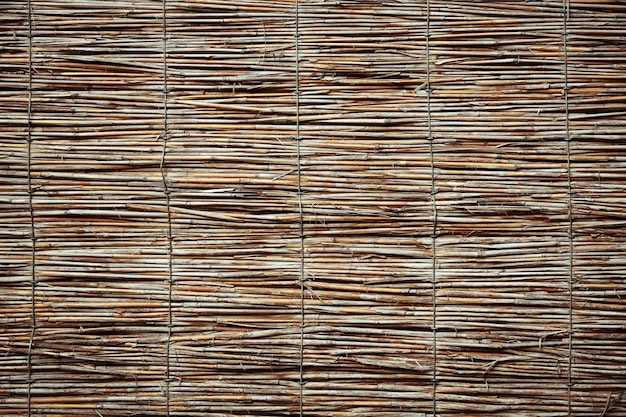 Cane wall texture. traditional fence background Premium Photo