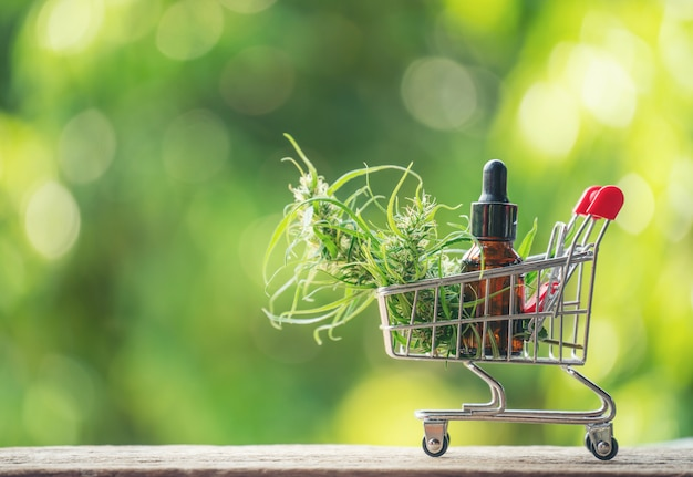 Cannabidiol (cbd) extract in a shopping cart Premium Photo