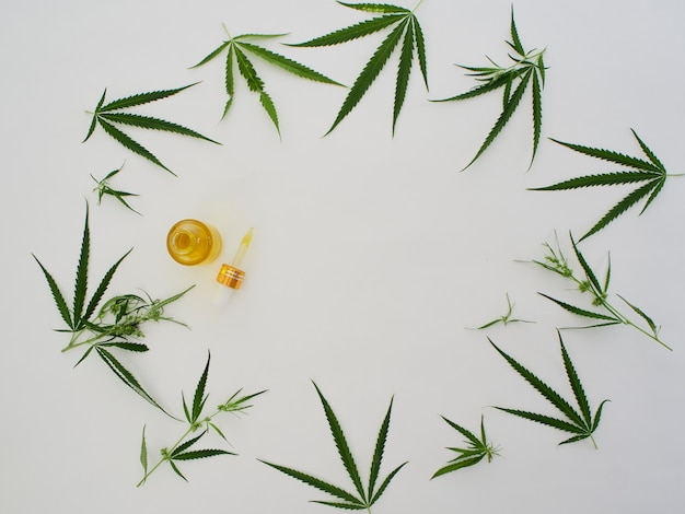 Cannabis with extract oil in a bottle Premium Photo