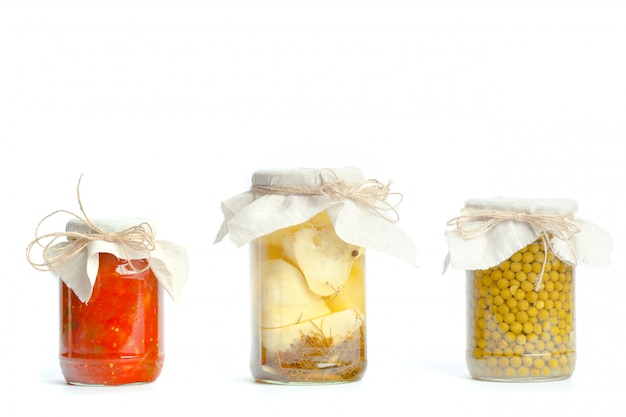 Canned vegetables in glass jars isolated on white background Premium Photo
