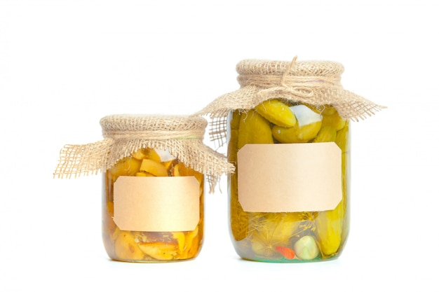 Canned vegetables in glass jars isolated on white Premium Photo