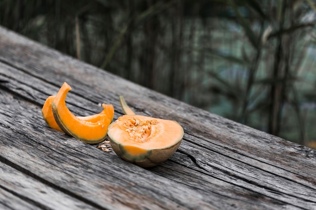 Cantaloupe melon on wooden table Free Photo