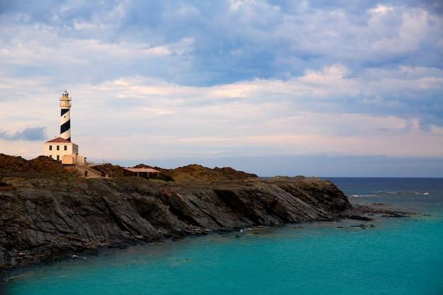 Cap de favaritx sunset lighthouse cape in mahon Premium Photo