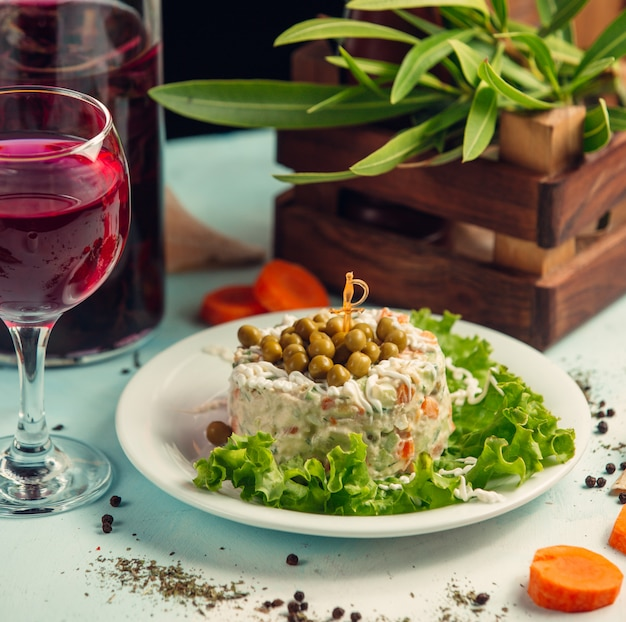 Capital salad with red wine on the table Free Photo