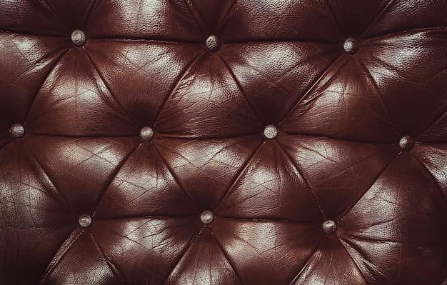 本革の装飾的な茶色の背景。本革capitoneテクスチャの装飾的な背景 Premium写真