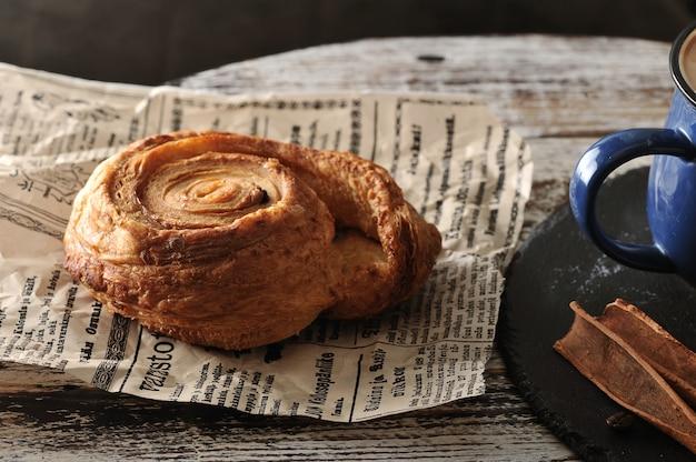 Cappuccino in a mug, cinnamon roll dough Premium Photo