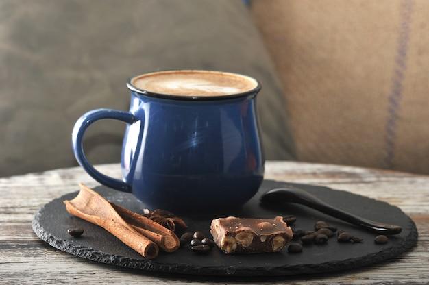 Cappuccino in a mug with milk foam and cinnamon and chocolate Premium Photo