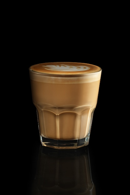 Cappuccino in rocks glass isolated on black Premium Photo
