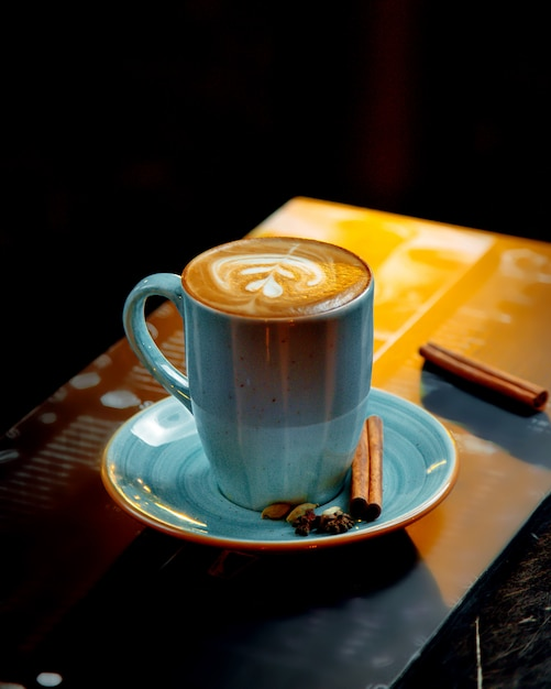 Cappuccino served in blue cup Free Photo