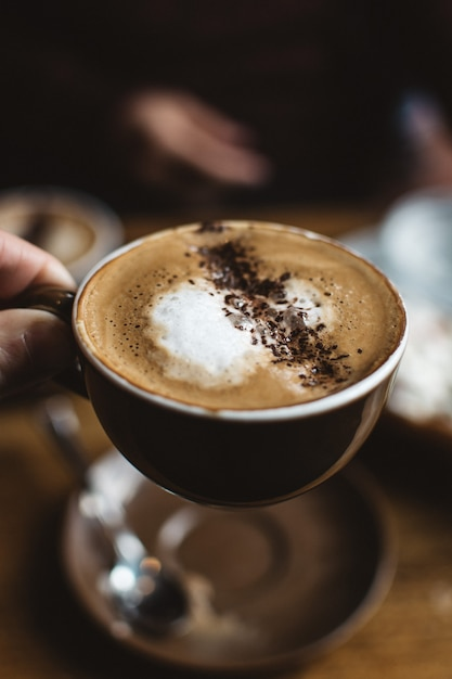 Cappuccino with cocoa sprinkle Free Photo