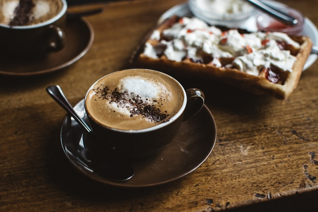 Cappuccino with waffle Free Photo