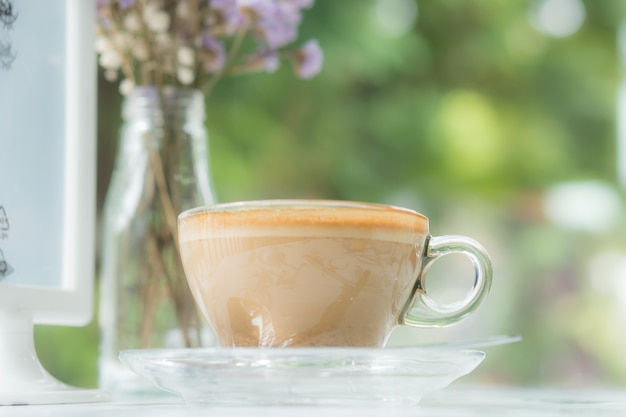 Cappuccinu coffee in clear cup on table cafe Premium Photo