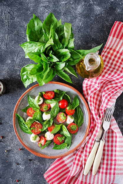 Caprese salad. healthy meal with cherry tomatoes, mozzarella balls and basil. Premium Photo