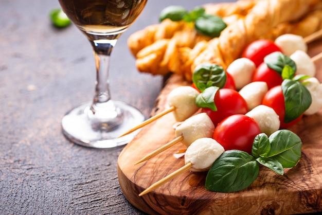 Caprese skewers and grissini bread Premium Photo