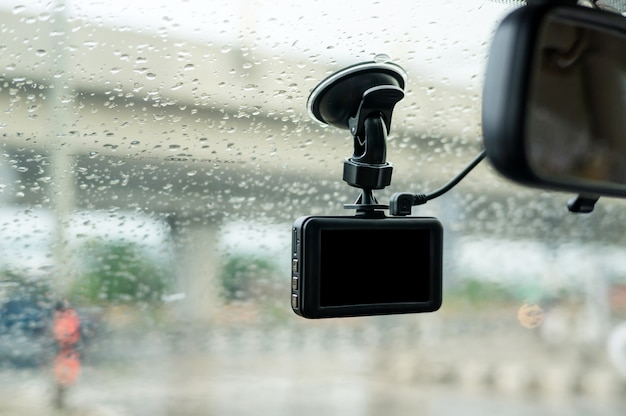 Car camera installed on a windshield. Premium Photo