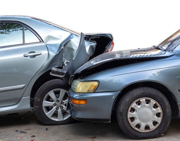 Car crash accident on street with wreck and damaged automobiles. Premium Photo