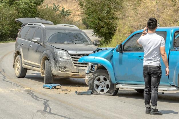 Car crash from car accident on the rural road between saloon versus pickup wait insurance. Premium P