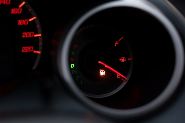 The car dashboard shows the flue gas with red. the oil warning light Premium Photo