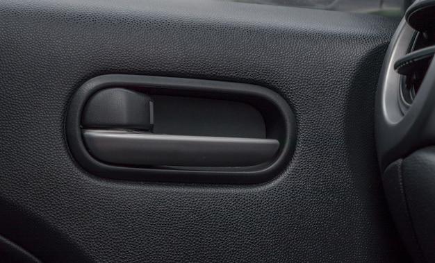 Car door lock lever inside driver place. Premium Photo