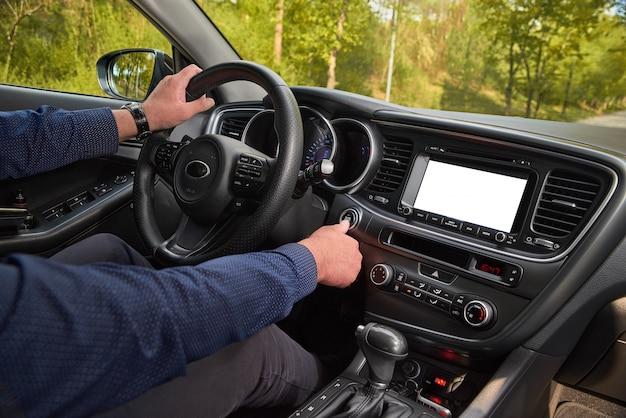 Car driver starting the engine start, stop engine button Premium Photo