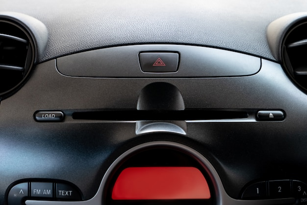 Car emergency button and cd/dvd player slot inside driver place. Premium Photo