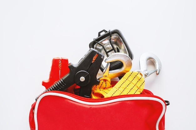 Car emergency kit on white background Premium Photo