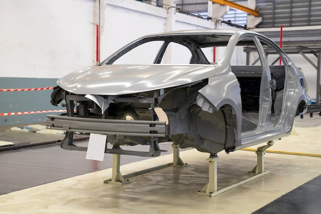 Car frame with unfinished assembly in the tester line of the automobile factory Premium Photo