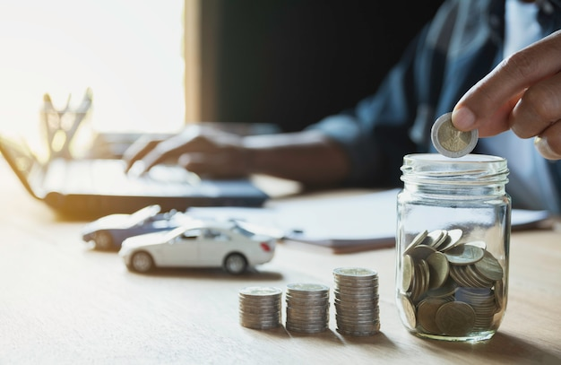 Car insurance and car service with stack of coins. Premium Photo