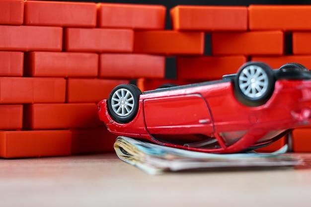 Car insurance concept. broken car and a pile of usd banknotes Premium Photo