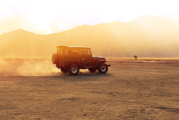 A car is running on the offroad desert in the morning. outdoor adventure life Premium Photo