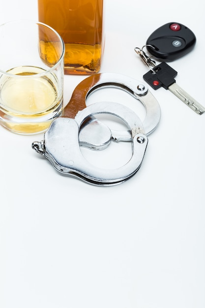 Car key on the bar with spilled alcohol Premium Photo