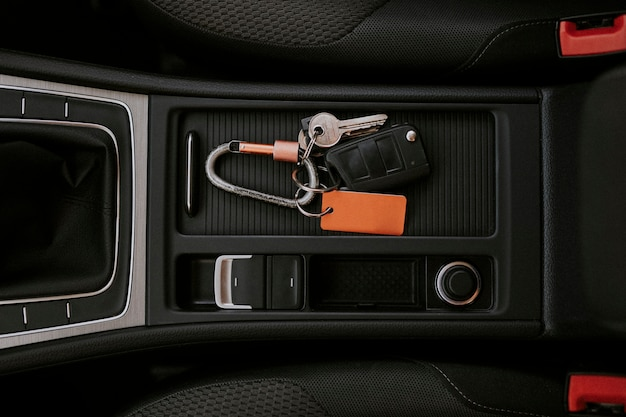 Car key in a center console space Free Photo