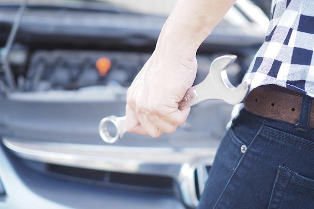 Car mechanic hand with a car repair wrench. Premium Photo