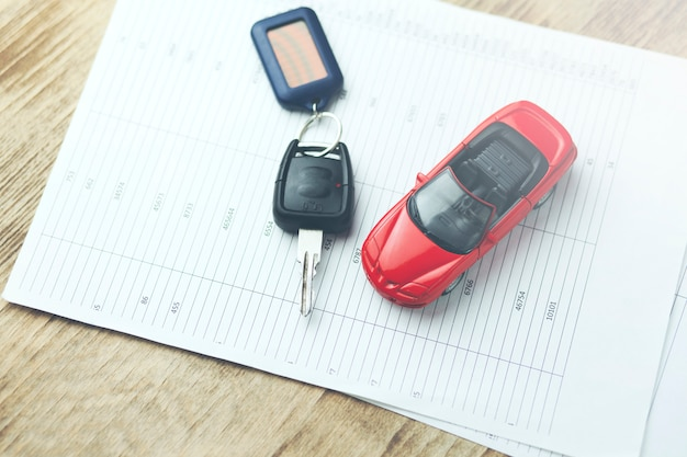 Car model and auto key on documents Premium Photo