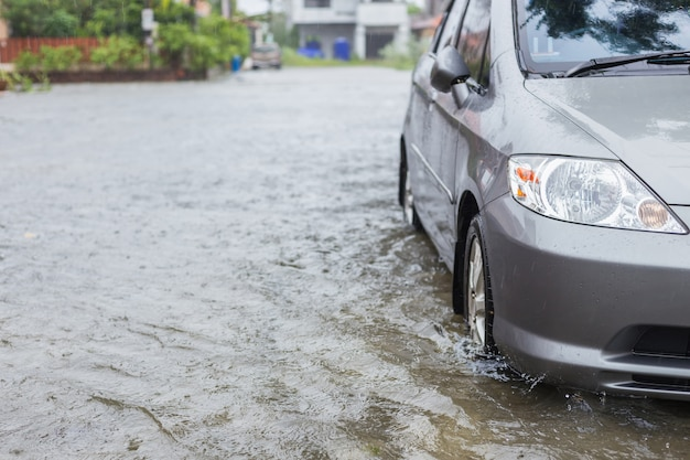 Car parking on the street of village while raining Premium Photo