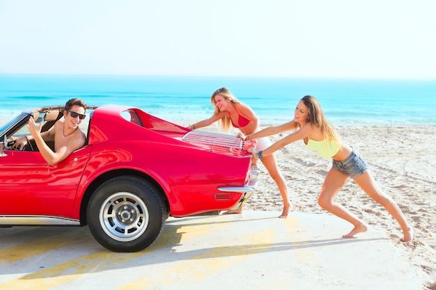 Car pushing teen girls humor funny guy driving Premium Photo